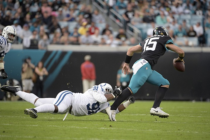 Indianapolis Colts defensive tackle Trevon Coley (91) dives after Jacksonville Jaguars quarterback Gardner Minshew II (15) during the first half of a game Sunday, Dec. 29, 2019, in Jacksonville, Fla. (Phelan M. Ebenhack/AP, file)