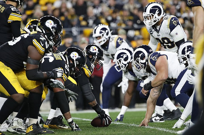 In this Nov. 10, 2019, photo, the Pittsburgh Steelers offense, left, lines up against the Los Angeles Rams' defense during the first half of a game in Pittsburgh. (Don Wright/AP, file)