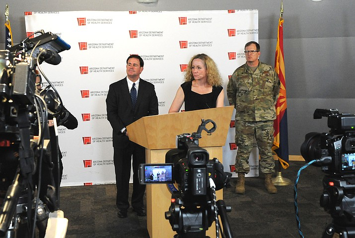 Gov. Doug Ducey and state Health Directory Cara Christ at a press conference Wednesday, March 25, 2020. Ducey ordered Arizona hospitals to come up with plans to increase bed capacity by 50 percent within the next month and actually have half of those ready to go by April 10. Ducey's executive order comes a day after Christ acknowledged that the current supply of hospital beds is unlikely to be enough to meet the needs given how many Arizonans will need treatment for COVID-19. (Howard Fischer/Capitol Media Services)