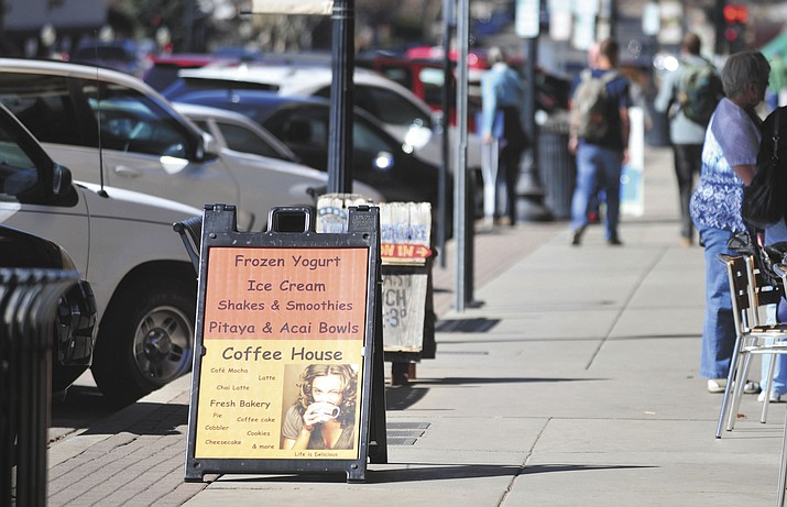 In this undated file photo, a temporary sign in shown in downtown Prescott. Local restaurants, bars and other businesses will have more flexibility in using signs to alert customers to alternative services during the COVID-19 pandemic, after the city lifted its existing temporary sign code provisions this week. (Courier file photo)