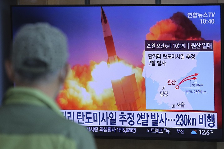 "A man watches a TV screen showing a file image of North Korea's missile launch during a news program at the Seoul Railway Station in Seoul, South Korea, Sunday, March 29, 2020. North Korea on Sunday fired two suspected ballistic missiles into the sea, South Korea said, calling it ""very inappropriate"" at a time when the world is battling the coronavirus pandemic. The Korean letters read: "" North Korea launched two suspected ballistic missiles into the sea."" (Ahn Young-joon/AP)"