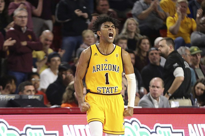 In this Feb. 22, 2020, file photo, Arizona State's Remy Martin (1) shows his feelings after a run by his Sun Devils against Oregon State during the second half of an NCAA college basketball game in Tempe, Ariz. Martin was selected to the Associated Press All Pac-12 team selected Tuesday, March 10, 2020. (Darryl Webb/AP, file)