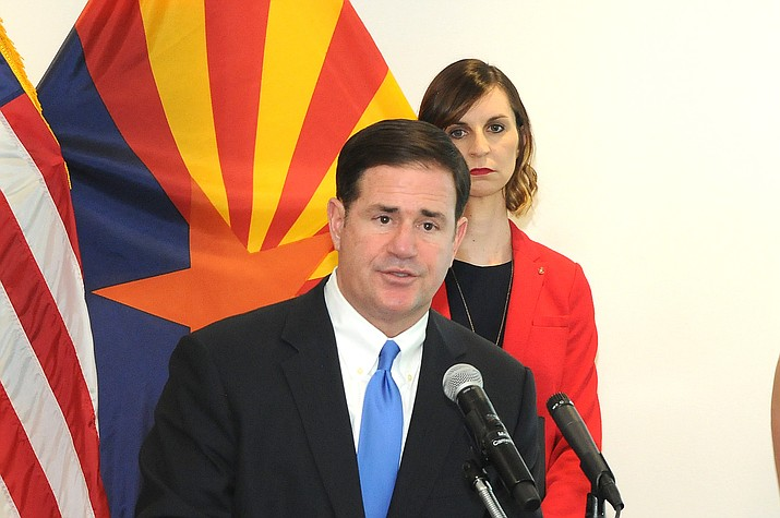 "Gov. Doug Ducey speaks at a press conference Monday, March 30, 2020, to announce a ""Stay at Home"" order for Arizona residents. (Howard Fischer/Capitol Media Services)"