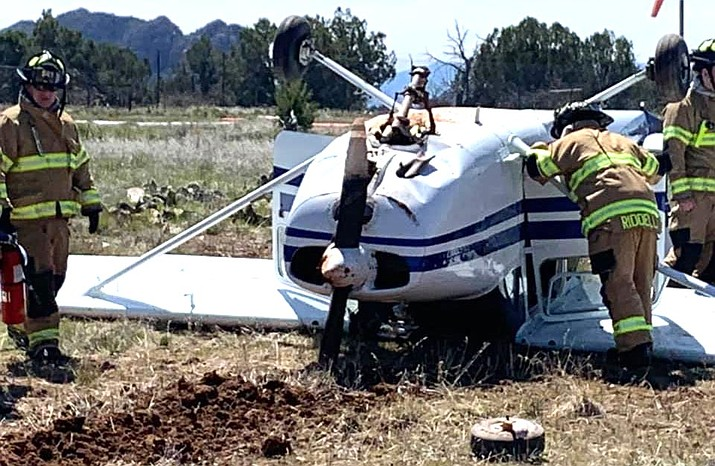 "Sedona Fire District was called to the airport at about noon on a report of the single-engine aircraft that had ""flipped over"" near the runway upon landing. Emergency responders found the plane upside down. Sedona Fire District courtesy photo"