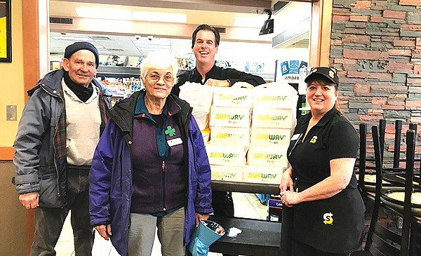 Tora Moody and Lu Carle with the Williams Senior Center accept sandwich and chip donations from Subway March 25. (Submitted photo)