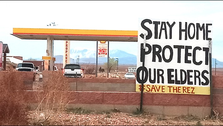 The Yazzie family posts signs around the community of Leupp reminding the public to stay home and do their part to protect elders and others from the coronavirus. (Submitted photo)