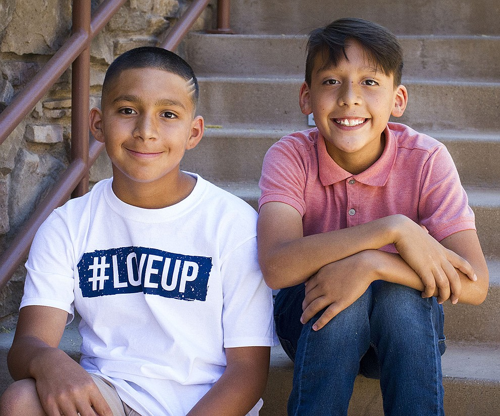 "Angel and Juan are incredibly hopeful of having a forever family to call their own. Both boys share that they really want a ""football family"" and would love to go to Disneyland and attend church. Angel is an ASU fan, while Juan is an OSU fan.  Both brothers dream of playing college football some-day. Get to know Angel and Juan at https://www.childrensheartgallery.org/profile/angel-and-juan, and other adoptable children at the childrensheartgallery.org..."