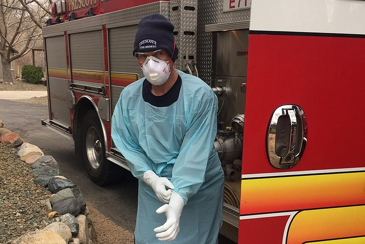 Prescott Fire Department medic Ryan Murphy puts on personal protective gear at the scene of a 911 call in Prescott where someone may have COVID-19 on Tuesday, March 31, 2020. (Prescott Fire Department/Courtesy)