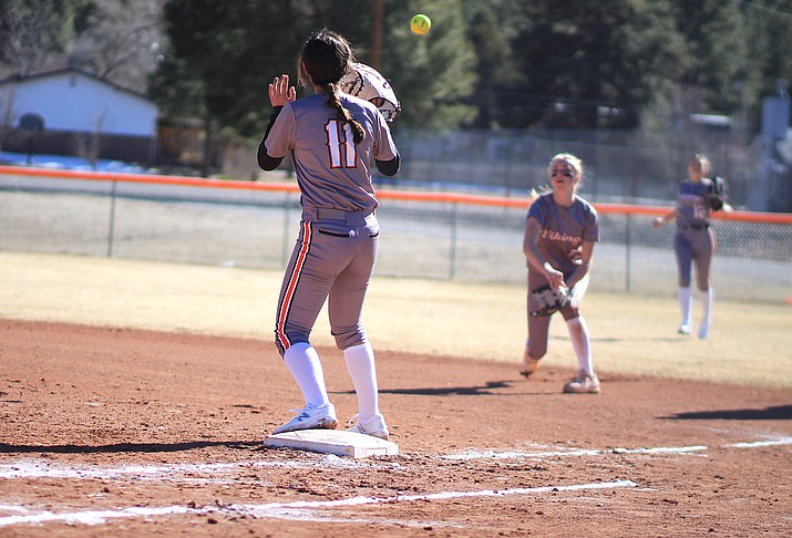 Sydnee Mortensen throws the ball to Jessica Zabala in an early March softball game at Williams High School. The Arizona Interscholastic Association has cancelled all athletics for the remainder of the 2019-2020 school year because of COVID-19 closures. (Wendy Howell/WGCN)