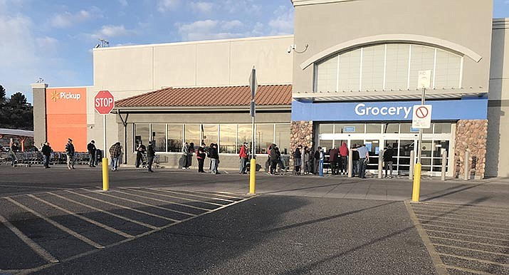 Customers line up on a recent day at the Cottonwood Walmart before the store opens for business. Mark Miller, president of the Arizona Food Marketing Alliance, in an email interview, discussed how panic led to hoarding but warehouses and stores are being replenished. VVN/Jason W. Brooks