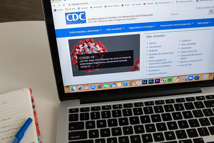 The CDC provides information about COVID-19 for residents of the United States who don't speak English. (Photo illustration by Delia Johnson/Cronkite News)