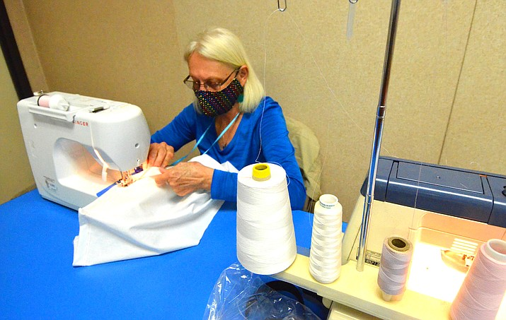 Gail Basham sews a hospital gown for the Verde Valley Medical Center on her sewing machine in Cottonwood. VVN/Vyto Starinskas