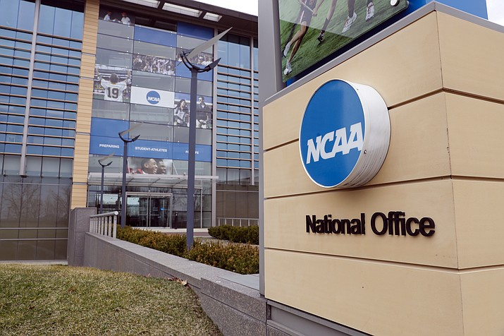 In this March 12, 2020, file photo, The national office of the NCAA in Indianapolis is viewed. The NCAA will permit spring sport athletes _ such as baseball, softball and lacrosse players _ who had their seasons shortened by the coronavirus outbreak to have an additional year of eligibility. The NCAA Division I Council voted Monday, March 30, 2020, to give spring sport athletes regardless of their year in school a way to get back the season they lost, but did not guarantee financial aid to the current crop of seniors if they return to play next year. (Michael Conroy/AP, file)