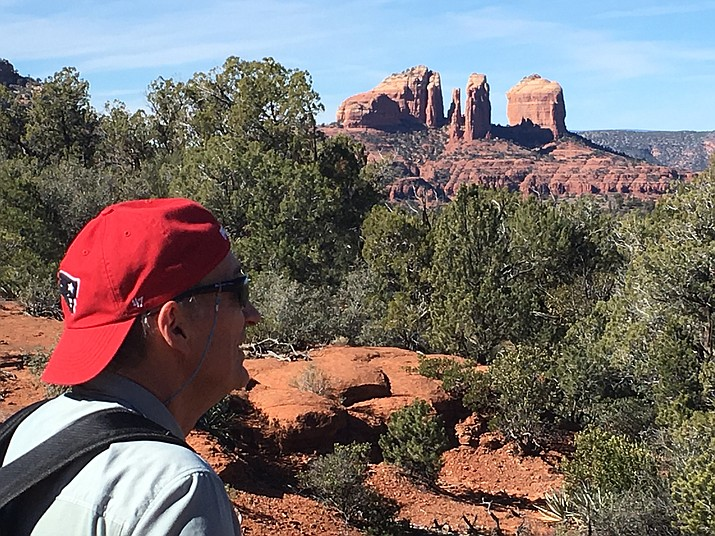 A hiker from Massachusetts looks at the popular Cathedral Rock in Sedona from the Courthouse Vista Trailhead area. Both are closed to hikers now. VVN/Vyto Starinskas