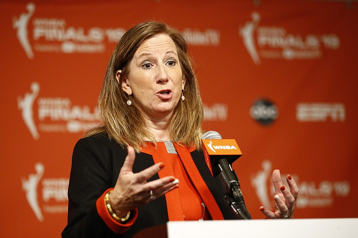 "In this Sept. 29, 2019, file photo, WNBA Commissioner Cathy Engelbert speaks at a news conference before Game 1 of basketball's WNBA Finals between the Connecticut Sun and the Washington Mystics, in Washington. The WNBA draft will be a virtual event this year. The league announced Thursday, March 26, 2020, that its draft will still be held April 17 as originally scheduled, but without players, fans or media in attendance due to the coronavirus pandemic. ""The WNBA draft is a time to celebrate the exceptional athletes whose hard work and dreams are realized with their selections in the draft,"" WNBA Commissioner Cathy Engelbert said. (Patrick Semansky/AP, file)"