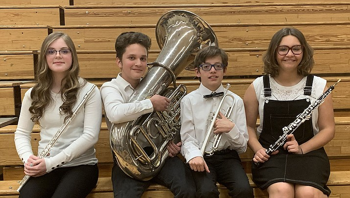 Kingman Middle School students who qualified for the Arizona Music Educators Association's All-State Honor Band Festival are, from left, Rylee Warren (eighth-grade, flute), Joseph McCoy (seventh-grade, Tuba), Taylor Haller (seventh-grade, trumpet) and Madison Guin (seventh-grade, oboe). Carsten Moser (sixth-grade, euphonium) is not shown. (Kingman Middle School courtesy photo)