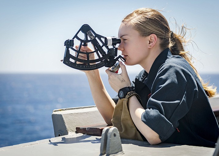 U.S. Navy Ensign Hannah Mauldin of Prescott, stationed on the Arleigh Burke-class guided-missile destroyer USS McCampbell in the South China Sea, utilizes a stadimeter while standing on the bridge wing, according to a news release. This was done just prior to a replenishment-at-sea with the Lewis and Clark-dry cargo ship USNS Carl Brashear. The McCampbell is underway in the Indo-Pacific region while assigned to Destroyer Squadron (DESRON) 15, the Navy's largest forward-deployed DESRON and the U.S. 7th Fleet's principal surface force. (Mass Communication Specialist 2nd Class Markus Castaneda/Courtesy)