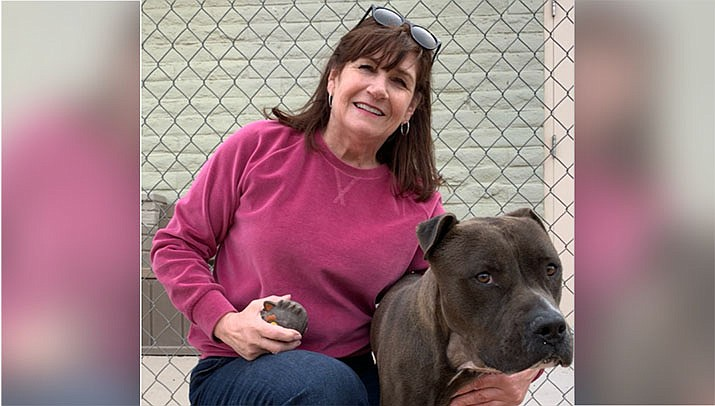 Lynn Kannianen, of Friends of Mohave County Animal Shelter, poses with Lucas. (Friends courtesy photo))