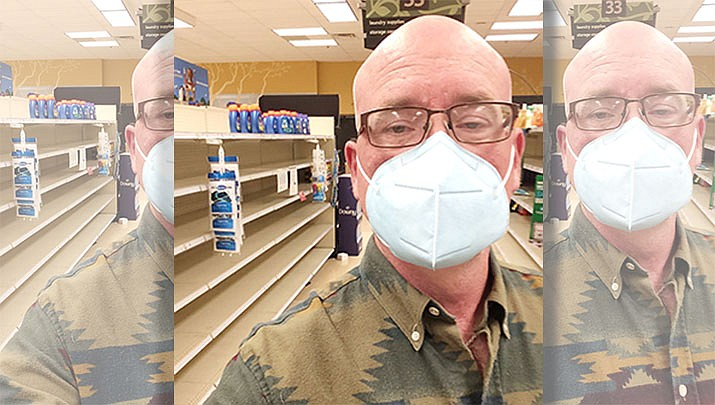 Two signs of the current times – empty shelves at the grocery store, and wearing a protective mask while out and about. (Tim Wiederaenders, self-portrait/Courier)
