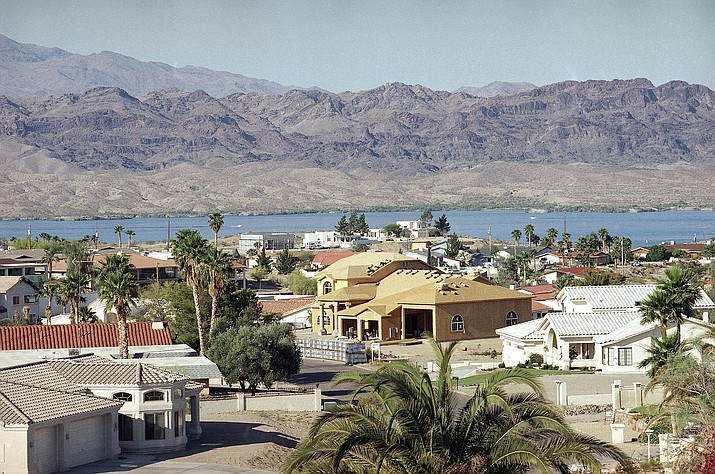 This 1999 file photo shows Lake Havasu from a distance. Amid the coronavirus pandemic that has forced the closure of many businesses and other tourism destinations, some Lake Havasu City residents are pushing for a closure of the popular lake that's a spring break mecca for many college students. (Stan Usinowicz/AP, file)