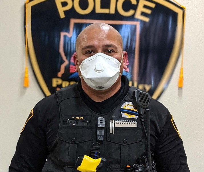 Prescott Valley Police Department Officer Bobby Ruiz models a mask similar to what the public may see officers wearing on calls or while interacting with the public. (PVPD/Courtesy)