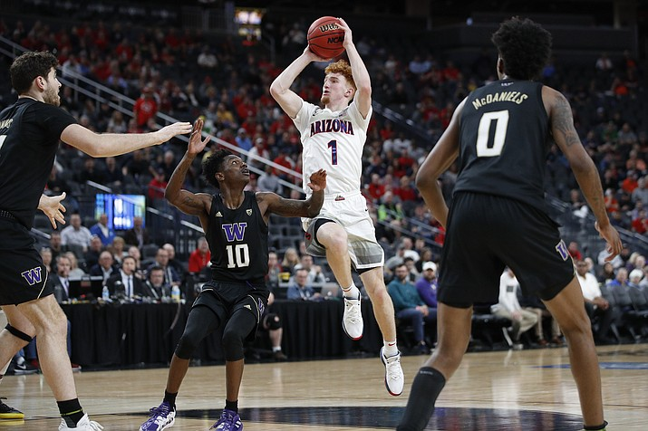Arizona's Nico Mannion (1) shoots over Washington's Elijah Hardy (10) during the second half of an NCAA college basketball game in the first round of the Pac-12 men's tournament Wednesday, March 11, 2020, in Las Vegas. (John Locher/AP, file)