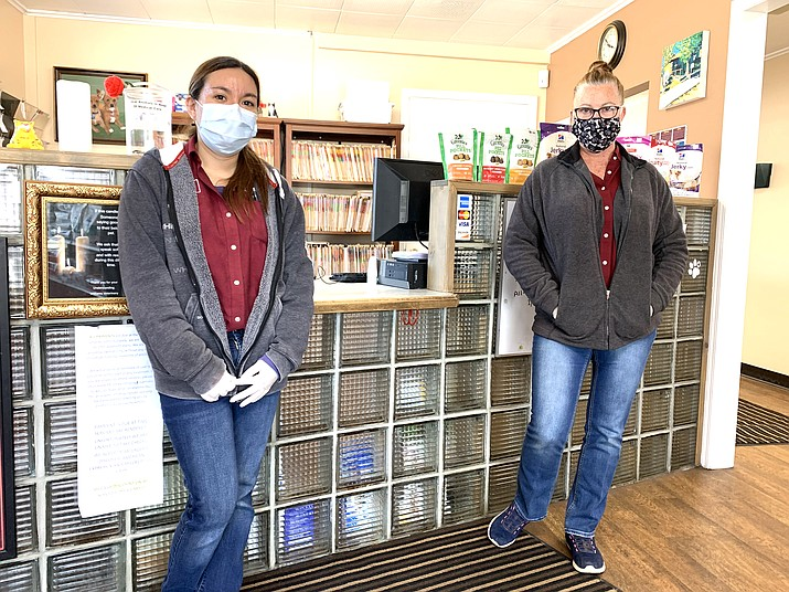 Williams Veterinary Clinic staff Angel Aguilar and Raina Marshall wear masks and gloves for protection. The clinic remains open for injured or ill animals. The clinic asks those in need of service to call prior to visiting. Wellness exams are currently being postponed until further notice. (Loretta McKenney/WGCN)