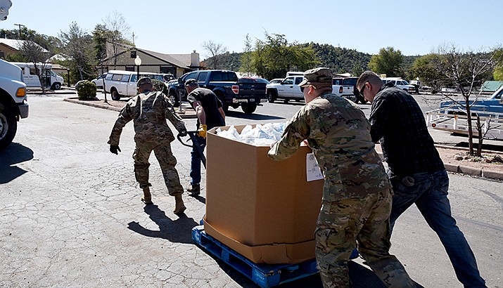 Members of the Arizona National Guard deliver food to a food bank in Payson on Monday. Under orders from Gov. Doug Ducey, the National Guard is providing support to food banks and grocery stores during the coronavirus pandemic. (Photo courtesy of Tech. Sgt. Michael Matkin/U.S. Air National Guard)