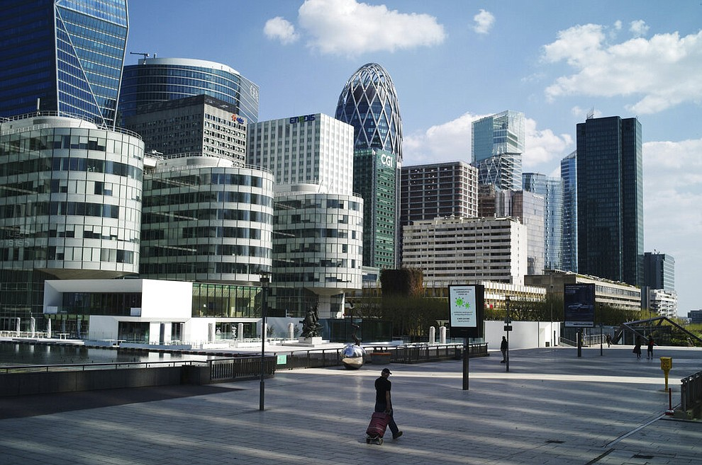A man walks on the square of La Defense business district during nationwide confinement measures to counter the Covid-19, in Paris, Thursday, April 9, 2020. The new coronavirus causes mild or moderate symptoms for most people, but for some, especially older adults and people with existing health problems, it can cause more severe illness or death. (AP Photo/Thibault Camus)