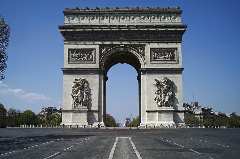View of the deserted Arc of Triomphe during nationwide confinement measures to counter the Covid-19, in Paris, Thursday, April 9, 2020. The new coronavirus causes mild or moderate symptoms for most people, but for some, especially older adults and people with existing health problems, it can cause more severe illness or death. (AP Photo/Thibault Camus)