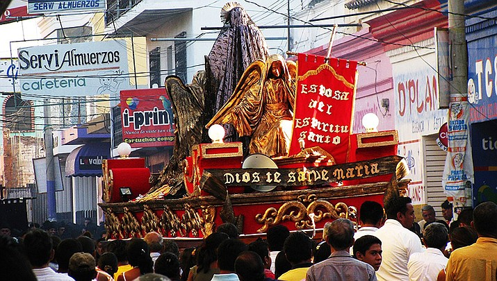Holy Week celebrations have a different feel this year due to the coronavirus pandemic. A 2010 Holy Week procession in Guatemala is shown above. (Photo by johrling, cc-by-sa-2,0, https://bit.ly/3b0Pr9q)