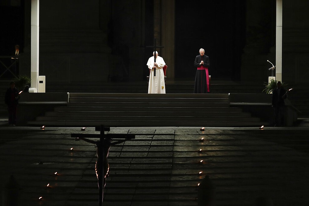 Pope Francis presides over the Via Crucis – or Way of the Cross – ceremony in St. Peter's Square empty of the faithful following Italy's ban on gatherings to contain coronavirus contagion, at the Vatican, Friday, April 10, 2020. The new coronavirus causes mild or moderate symptoms for most people, but for some, especially older adults and people with existing health problems, it can cause more severe illness or death. (AP Photo/Alessandra Tarantino)
