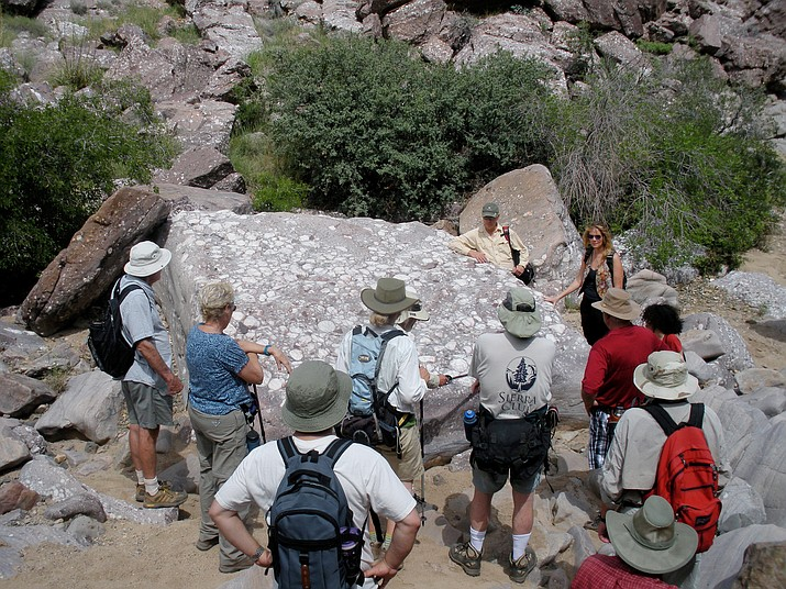 The group learns about this ancient and unusual boulder. (Nigel Reynolds/Courtesy)