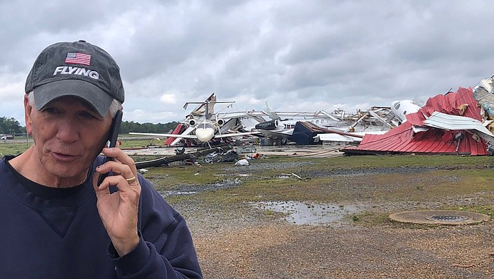 Rep. Ralph Abraham (R-La.) talks on his telephone in from of a destroyed hangar and damaged airplanes at Monroe Regional Airport in Monroe, La., on Sunday, April 12. Tornadoes swept through the deep south on Easter Sunday, killing at least 19 people. (Courtesy photo by Dianne Abrams)