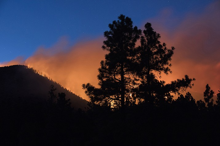 A wildfire burns through the Coconino National Forest, north of Flagstaff, Ariz. Arizona officials said April 9, that conditions in Arizona this year point toward a potential for high wildfire activity in the central part of the state and southward into desert areas where moist conditions during winter and early spring promoted growth of grasses. The state Department of Forestry and Fire Management said that outlook is based on conditions very similar to those of 2019. (Ben Shanahan/Arizona Daily Sun via AP, File)
