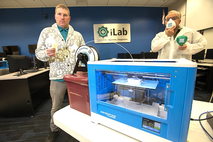 Michael Mercia, director of Institutional Research and Jeff Jones, dean of Career and Technical Education, at Coconino Community College demonstrate how 3D mask printing is accomplished. (Submitted photo)