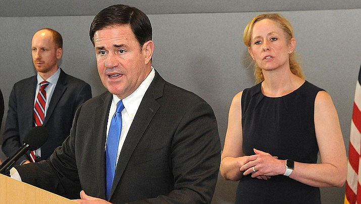 Arizona officials have announced an estimated $1.1 billion budget shortfall for the year ending June 30, 2020, due to the coronavirus. Arizona Gov. Doug Ducey is shown above at a news conference. (Photo by Howard Fischer/For the Miner)