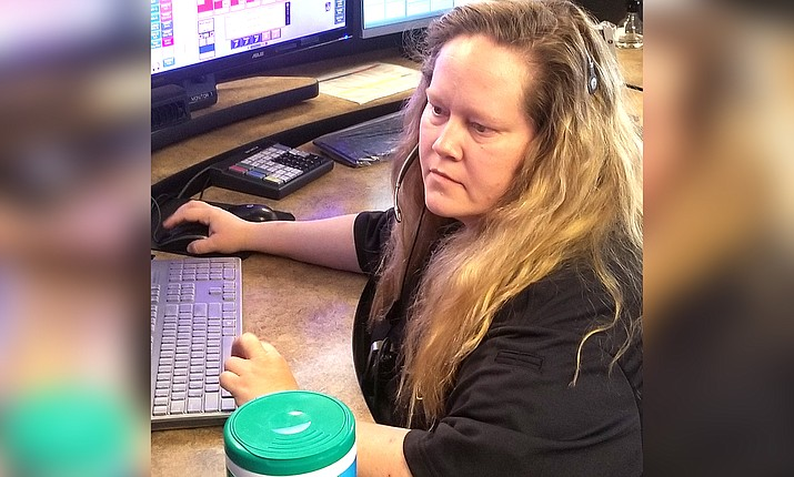 Jennifer Noss looks over a screen at the Cottonwood Public Safety Communications Center. As we observe National Public Safety Telecommunicators Week, we look at how the role of the emergency dispatcher is more critical than ever during the COVID-19 pandemic. Courtesy of Cottonwood PD