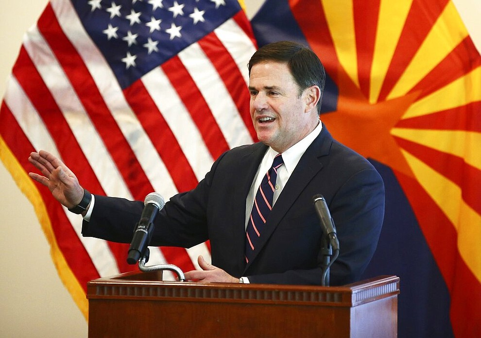Arizona Gov. Doug Ducey gives an update on the COVID-19 pandemic response Tuesday, April 14, 2020 during a press conference at the Arizona Commerce Authority in Phoenix. (Rob Schumacher/The Arizona Republic via AP, Pool)