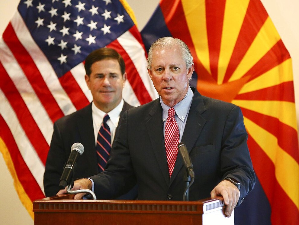 Dr. Robert C. Robbins, president of the University of Arizona, and Arizona Gov. Doug Ducey give an update on the COVID-19 pandemic response Tuesday, April 14, 2020 during a press conference at the Arizona Commerce Authority in Phoenix. (Rob Schumacher/The Arizona Republic via AP, Pool)