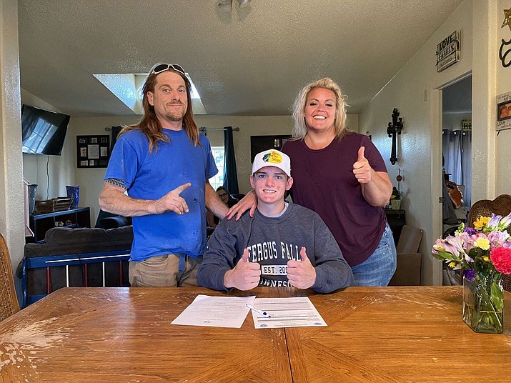 Chino Valley football linebacker Trevor Gianfrancesco, middle, signs his letter of intent to continue his athletic career at Minnesota State Community and Technical College in Fergus Falls, Minn. (Marty Campitelli/Courtesy)