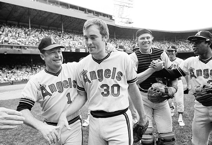 In this July 15, 1973, file photo, California Angels pitcher Nolan Ryan, 26, is congratulated by Angels manager Bobby Winkles after his no-hitter against the Detroit Tigers in Detroit. Catcher Art Kusnyer is at center right. The Angels won 6-0. Winkles, the former baseball coach who won three national championships at Arizona State and went on to manage in the majors, has died. He was 90. Arizona State said Winkles died Friday, April 17, 2020, with family and friends by his side. (AP Photo/Richard Sheinwald)