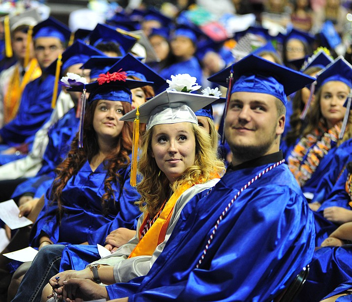 Watching the senior memories video on the big screens at the Chino Valley Commencement held in May 2018 at the Prescott Valley Event Center. Chino Valley Unified School District Superintendent John Scholl announced that the high school plans to postpone graduation until a later date. (Les Stukenberg/Review, file)