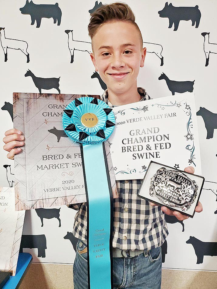 Hunter Peck of Mingus Union PALS wins Verde Valley Bred and Fed championship for his 265-pound pig in the Junior Market Swine Show Program. Courtesy Verde Valley Fair