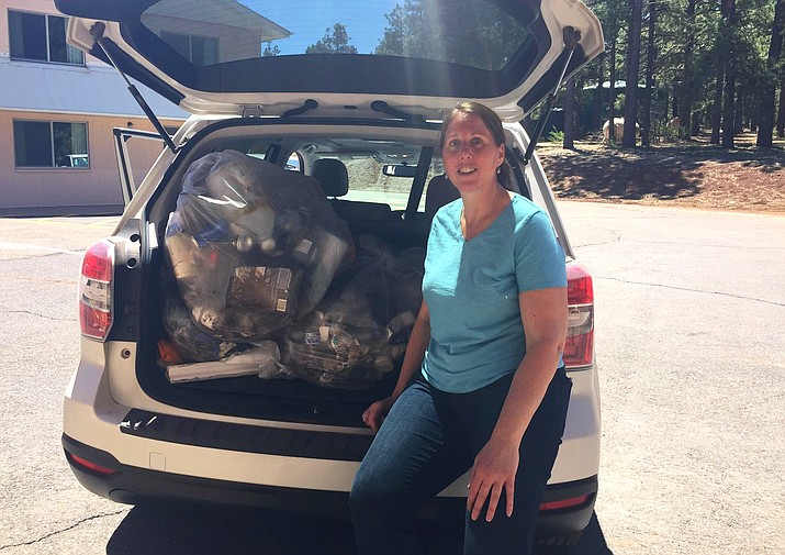 Michelle Gauthier (above) and Jody Monahan spent their weekend picking up garbage along I-40. Many people have noted the recent increase of trash between Williams and Flagstaff. The two local residents tackled an area near the International Kadampa Retreat Center and the Grand Canyon Deer Farm April 24-26. (Submitted photos)