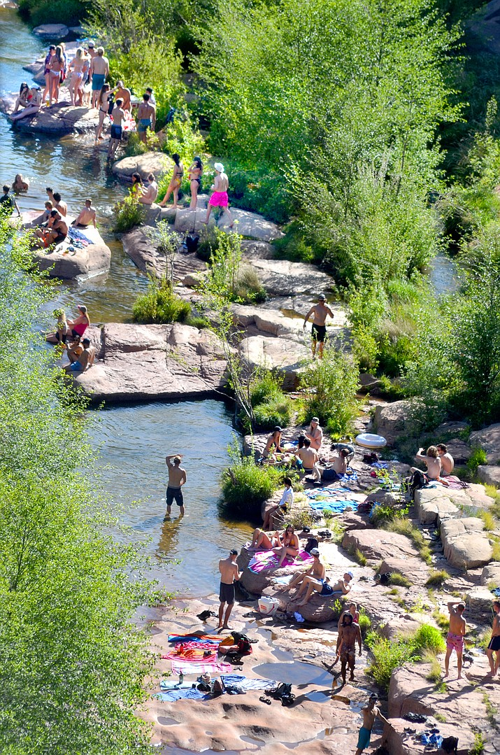 Sun worshippers hiked down to a popular swimming area below Midgley Bridge Saturday to cool down in Oak Creek. VVN/Vyto Starinskas
