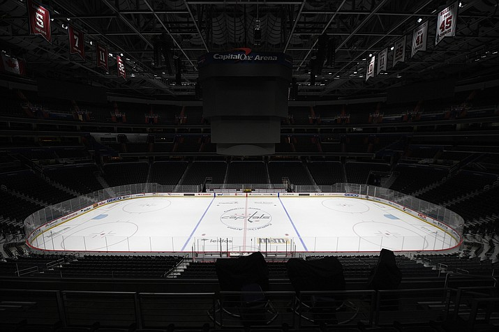 This is a March 12, 2020, file photo showing Capital One Arena, home of the Washington Capitals NHL hockey club in Washington. Get used to the concept of pods and pucks if the NHL is going to have any chance of completing its season, with the most likely scenarios calling for games in empty, air-conditioned arenas during the dog days of summer. (Nick Wass/AP, file)