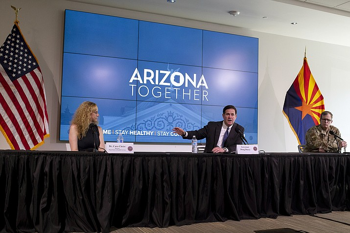 Gov. Doug Ducey speaks during a news conference about extending his statewide stay-at-home order, Wednesday, April 29, 2020, at the Arizona Commerce Authority Conference Center in Phoenix. (Sean Logan/The Arizona Republic via AP, Pool)