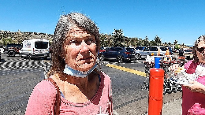 Linda Harkness, standing in front of Costco on April, 29, 2020, said she supports the change to having to wear a face covering, adding that it depends on the store's clientele. (Jesse Bertel/Courier)