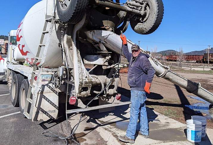 A worker from Arrow Concrete donates his time and materials for the new Glasburn Event Area. (Submitted photo)